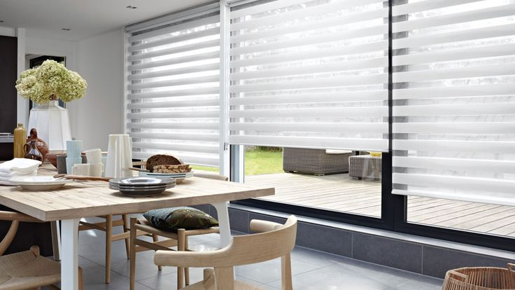 Twist™ Roller Blinds with two sliding layers of fabric with sheer horizontal strips. This is the hallmark of Luxaflex® Twist™ Roller Blinds, a contemporary Luxaflex window covering  - perfect for large windows. Perfect large window treatment. #Luxaflex #TwistShades #LargeWindow