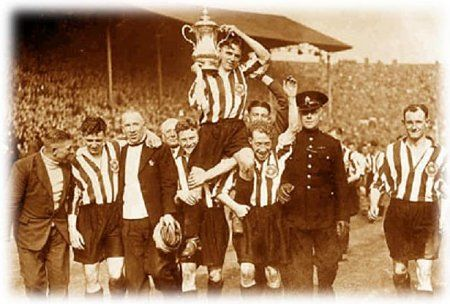 26) Triumph at Wembley. The Sunderland Soccer team, winners of the Football Association Cup in 1937.