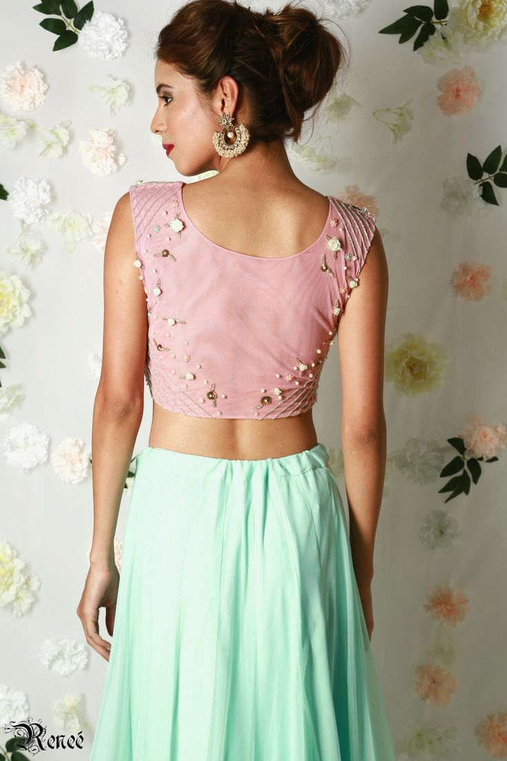 Blush pink georgette and net crop top with mint net lehenga by Renee label