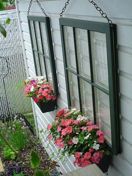 Paint and hang windows on back of garage with planters. I love this idea....super cottage looking