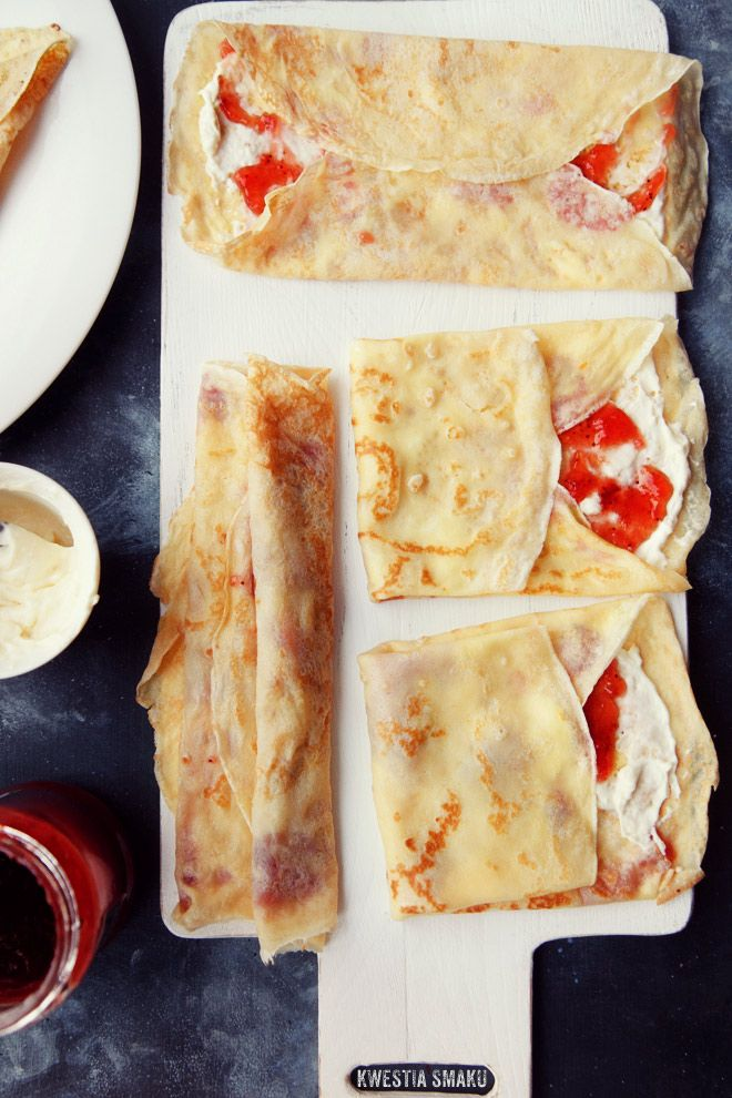 Crêpes with custard and strawberry jam