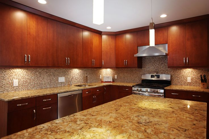 Cherry slab briarwood kitchen cabinets with a buckingham for Cambrian kitchen cabinets