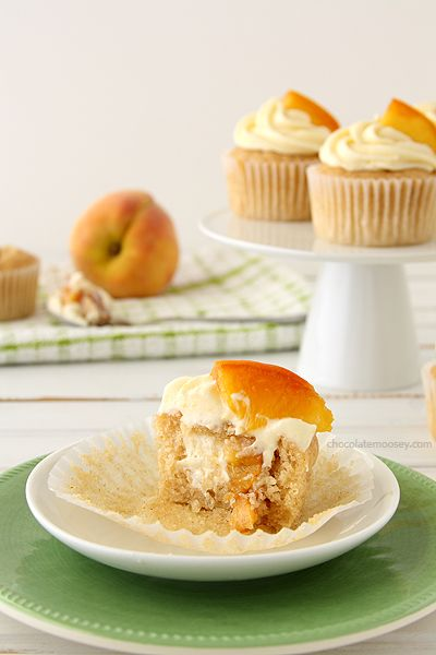Peaches and Cream Stuffed Cupcakes -- Spiced Cupcakes filled with Peach Cheesecake and topped with Cream Cheese Frosting
