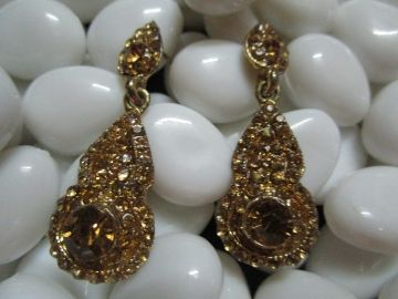 Antique gold earring with yellow stone.