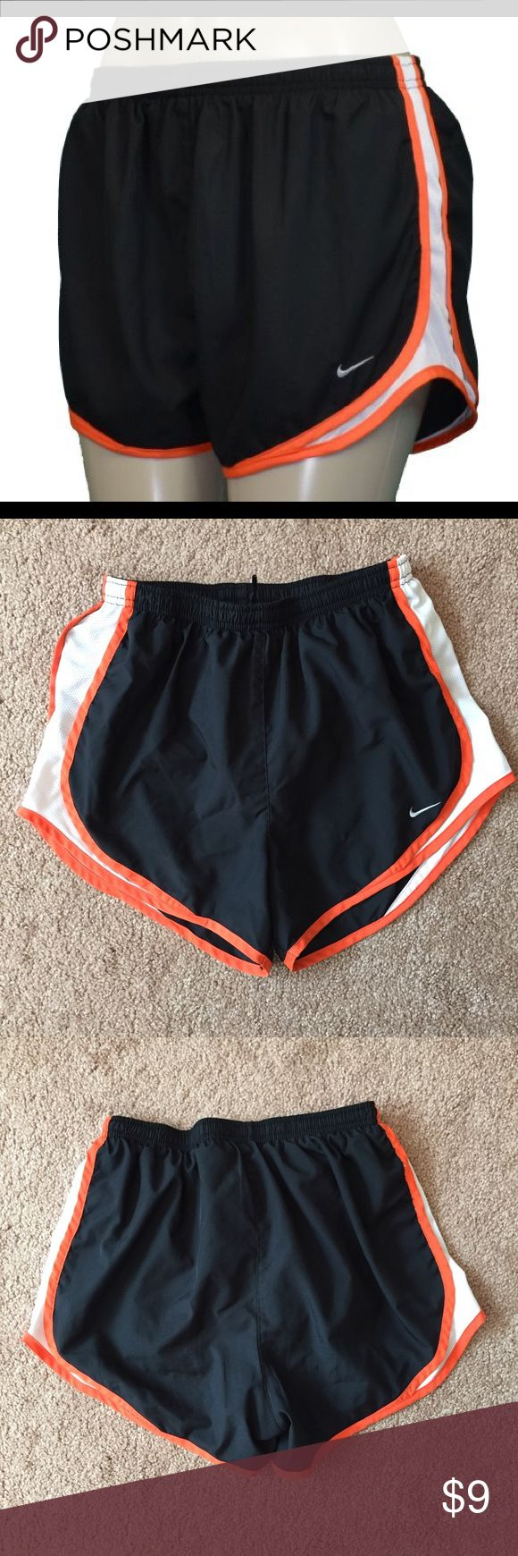 Women's Nike Dri Fit Shorts Black with orange trim Nike Dri Fit shorts. Washed and worn a few times but in great condition! Size small. Bundle 2 or more items and save 15% plus combined shipping! Nike Shorts