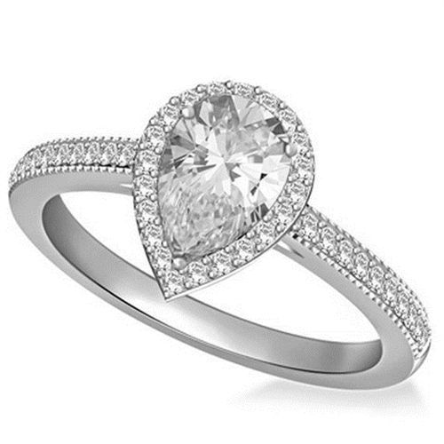 faf2fd5f542 DHBC054 - A pear cut diamond shoulder set ring with one large pear diamond  in the centre held in three prongs and smaller diamonds placed in the  shoulders ...