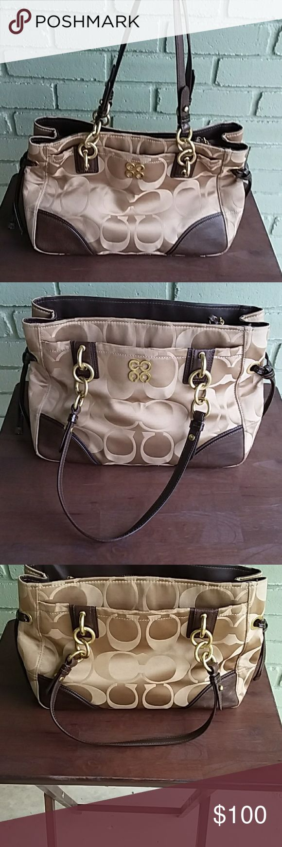 Gently Used Carmel and Brown Coach Purse Beautiful purse with 2 exterior pockets, 2 small inner pockets, a larger inner pocket and a zippered pocket in the center.  Has a couple of small stains on the top and some small stains on the interior.  Comes with a satin Coach storage bag also. Bags Shoulder Bags