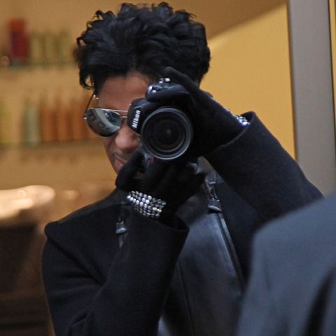 Prince with a NIKON on his hands. There's sth w this guy...
