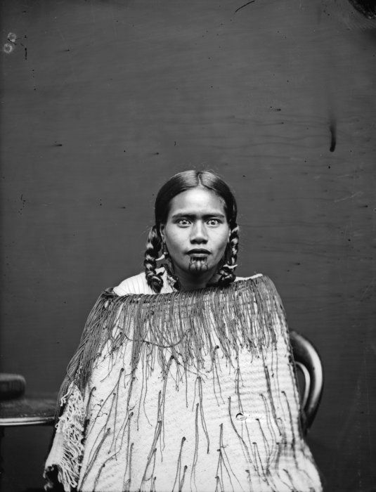 Carte de visite portrait of a Maori woman wearing a korowai (tag cloak), probably associated with the Pai Marire party who executed Carl Sylvius Volkner at Opotiki in 1864, taken in the 1870s by Samuel Carnell of Napier.