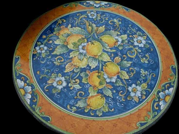 hand painted wall plate.you can oderd. send email to: erreci1958@yahoo.it and web page www.romeocuomoceramics.com