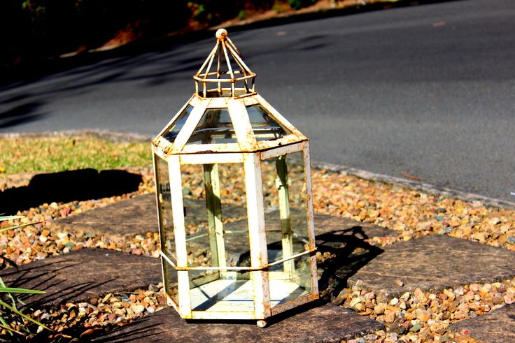 Rusted hurricane lamps