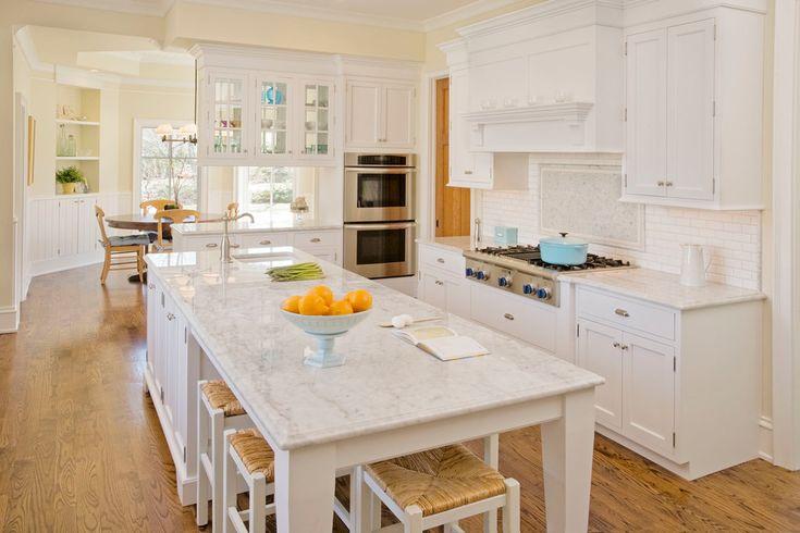 Elegant teakettle in Kitchen Traditional with Southwest Kitchen next to Double Oven Cabinet alongside Southwest Backsplash and Blue Knobs