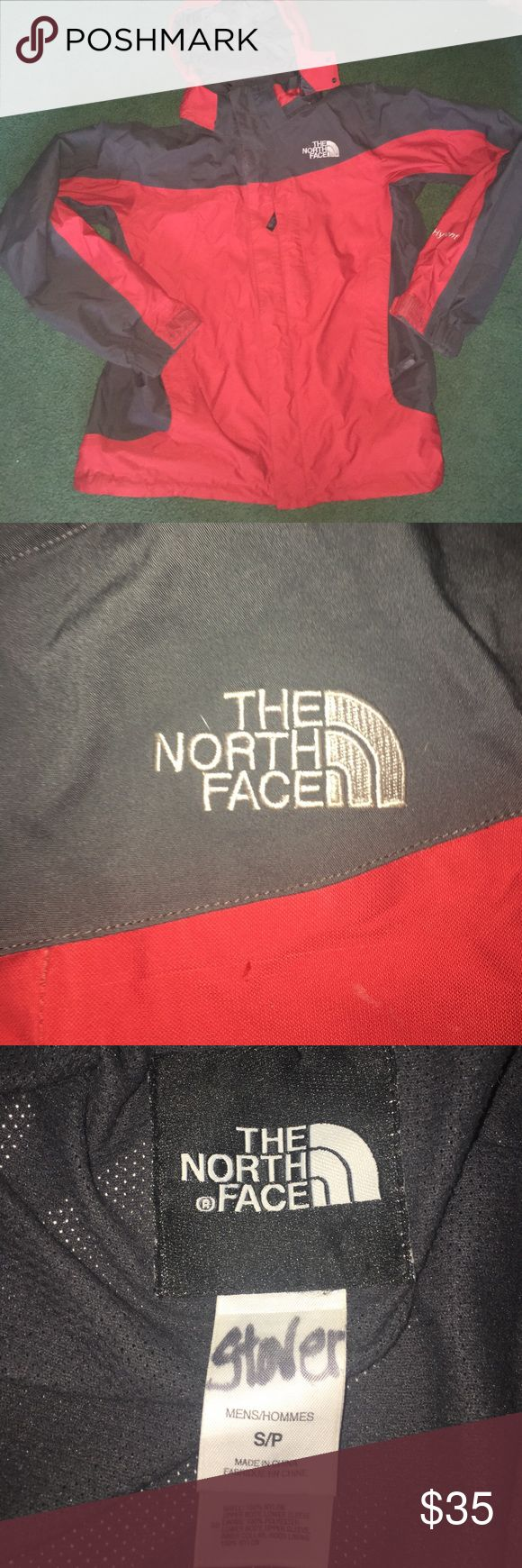 A men's small North Face Hyvent winter coat shell. It's red and grey. Has both a zipper and velcro. The North Face Jackets & Coats Performance Jackets