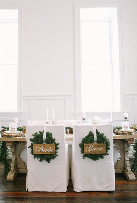 Decorate your bride and groom chairs with wreaths | http://Brides.com