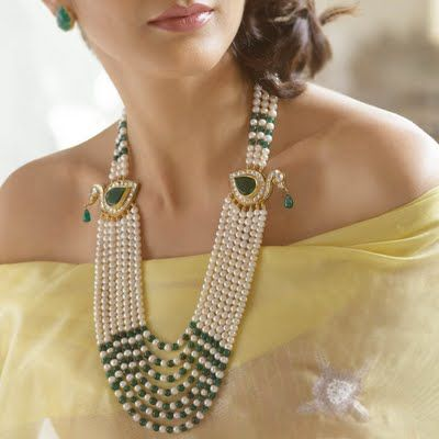 Pearls have always signified elegance and royalty. Pearl necklaces with emeralds or rubies have been worn by Rajput women from times immemorial. This necklace has traditional 'moriya' or peacock design as well. You will find the traditional moriya design in almost every rajputi jewellery. Earrings, necklaces, rani hars, kadas and almost every piece of jewellery possible often contains the peacock design.