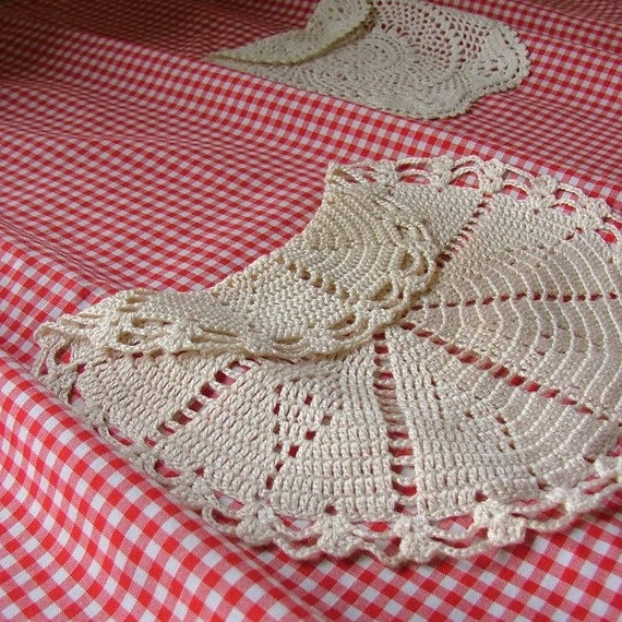 CREATIVE with a captial C.  Using old doilies for pockets on aprons...very classy. LOL