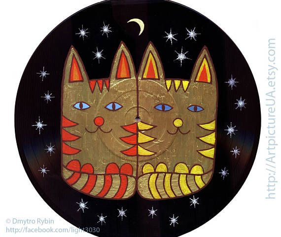 Two cats under the moon and stars. Lovers. Cat and cat.