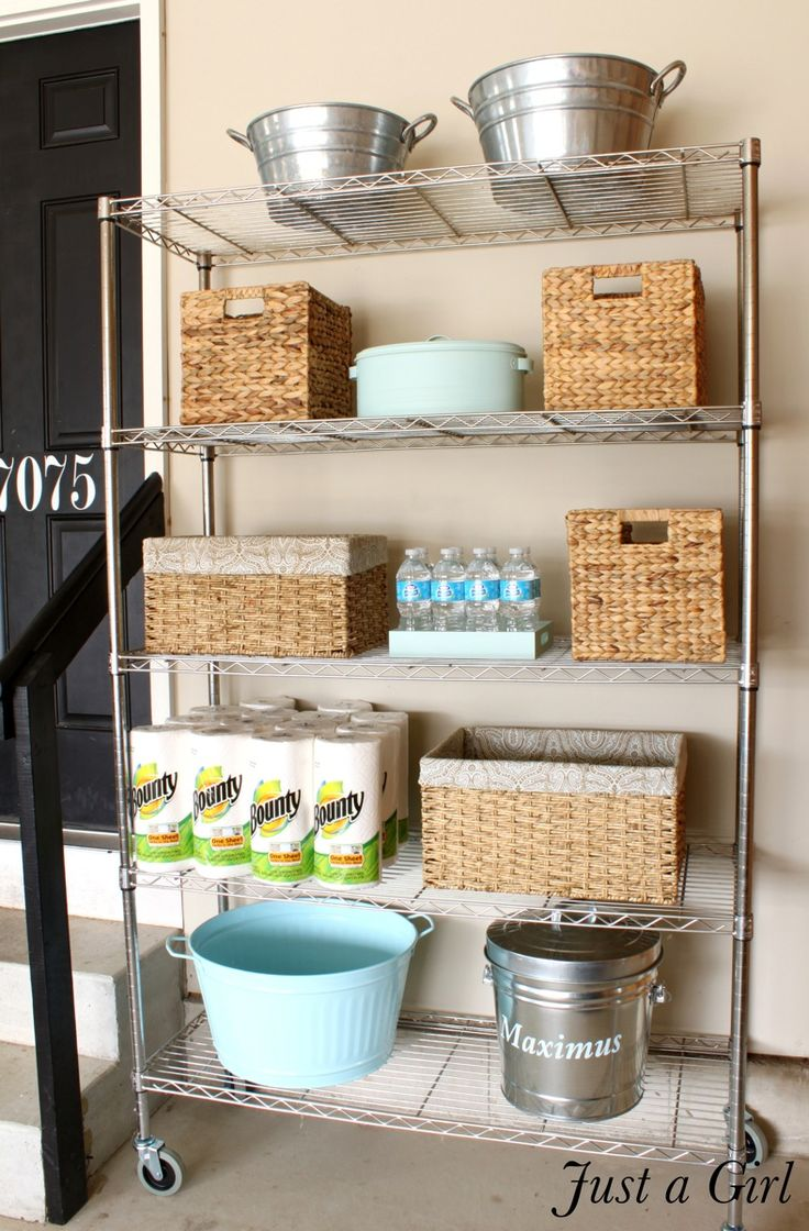 AFTER: A PRETTY SOLUTION Decorative baskets, galvanized buckets that match her nearby trash cans, and spray-painted containers created a cohesive vibe that wasn't too formal (or precious) for this working space.