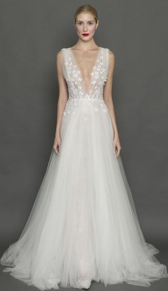 Elegant plunging neckline floral applique tulle wedding dress; Featured Dress: Francesca Miranda