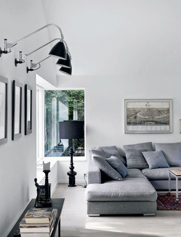 artwork, black lamp base, light fixtures, A+ with gray sofa