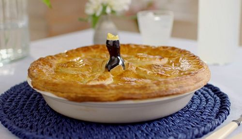 Mary Berry served up a potato, leek, cheese pie with French Dijon mustard, flaky pastry and a vegetarian filling on Mary Berry Everyday. The ingredients for the flaky pastry are: 125g butter, frozen for 1 hour, 125g hard vegetable fat, such as Trex, frozen for 1 hour, 350g plain flour, plus extra for dusting and 1 free-range egg, beaten for egg wash. For the pie filling: 60g butter, 2 small leeks, thinly sliced, 1 onion, thinly sliced, 450g potatoes, cut into 2cm cubes, 600ml full-fat milk…
