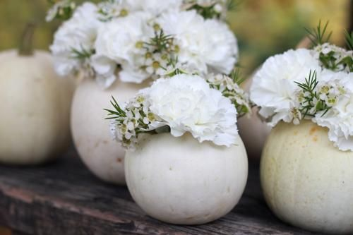 DIY instructions available at http://bklynbrideonline.com/25287/diy-projects/diy-how-to-make-white-pumpkin-centerpieces/
