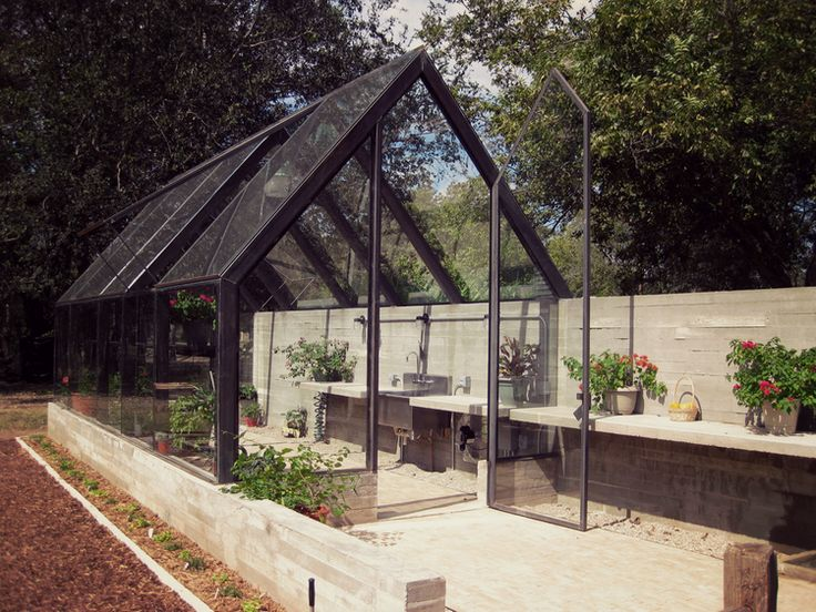 pavonetti design's greenhouse, a material palette of glass, steel and concrete