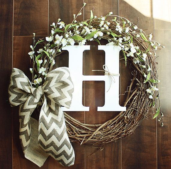 Monogrammed Grapevine Wreath with white flower details intertwined  a Chevron Burlap Bow