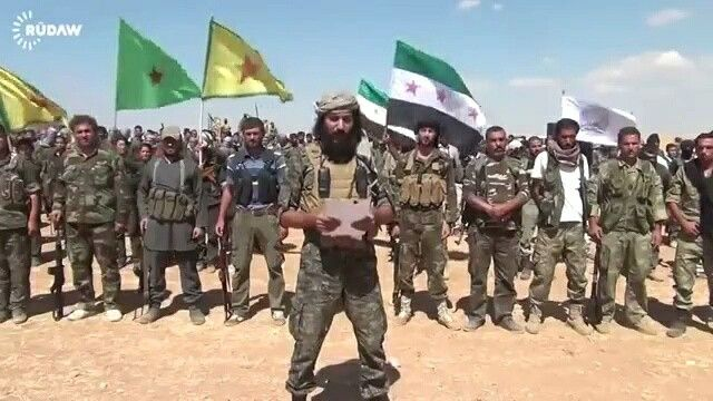 The #Kurdish YPG and the Terrorist FSA fight side by side!  Now do you see why we have an issue with the separtist #Kurds? With their demands for autonomy, with their desires for balkanization, with their efforts for having their own federation on #SYRIAN soil?  In this picture the FSA and YPG units announce the formation of the Burkan Al-Firat coalition to combat. (9/2014) #news #Syria #russia #Iran #Iraq #USA #Europe #Politic