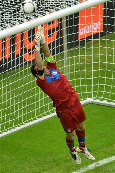 Italian goalkeeper Gianluigi Buffon jumps for the ball during the Euro 2012 football championships semi-final match Germany vs Italy on June 28, 2012 at the National Stadium in Warsaw.