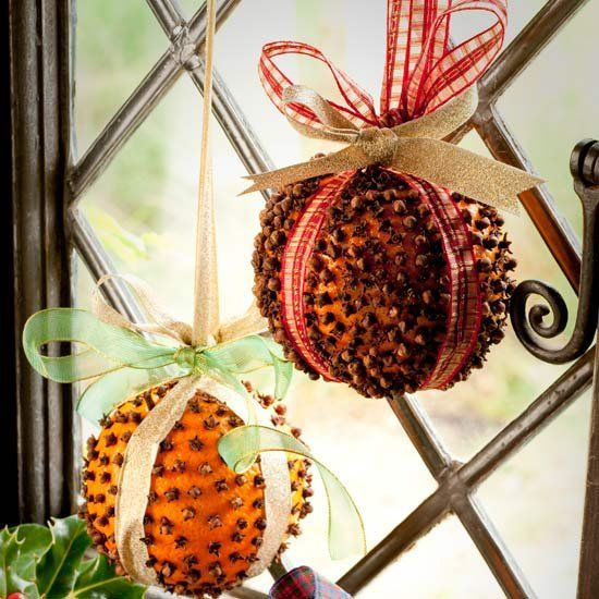 THE SMELL OF CHRISTMAS - Cover an orange with whole cloves then wrap a ribbon around it to hang.  More cloves is better than few.  The cloves preserve the orange.  To few cloves and the orange will wither and mold.