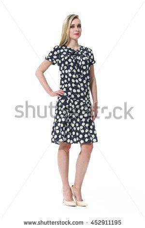 blond European model in summer casual polka dot short sleeve dress high heel sandals. full body photo isolated on white