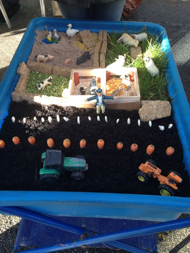 Farm small world play tray with weetabix hay bails and real carrots