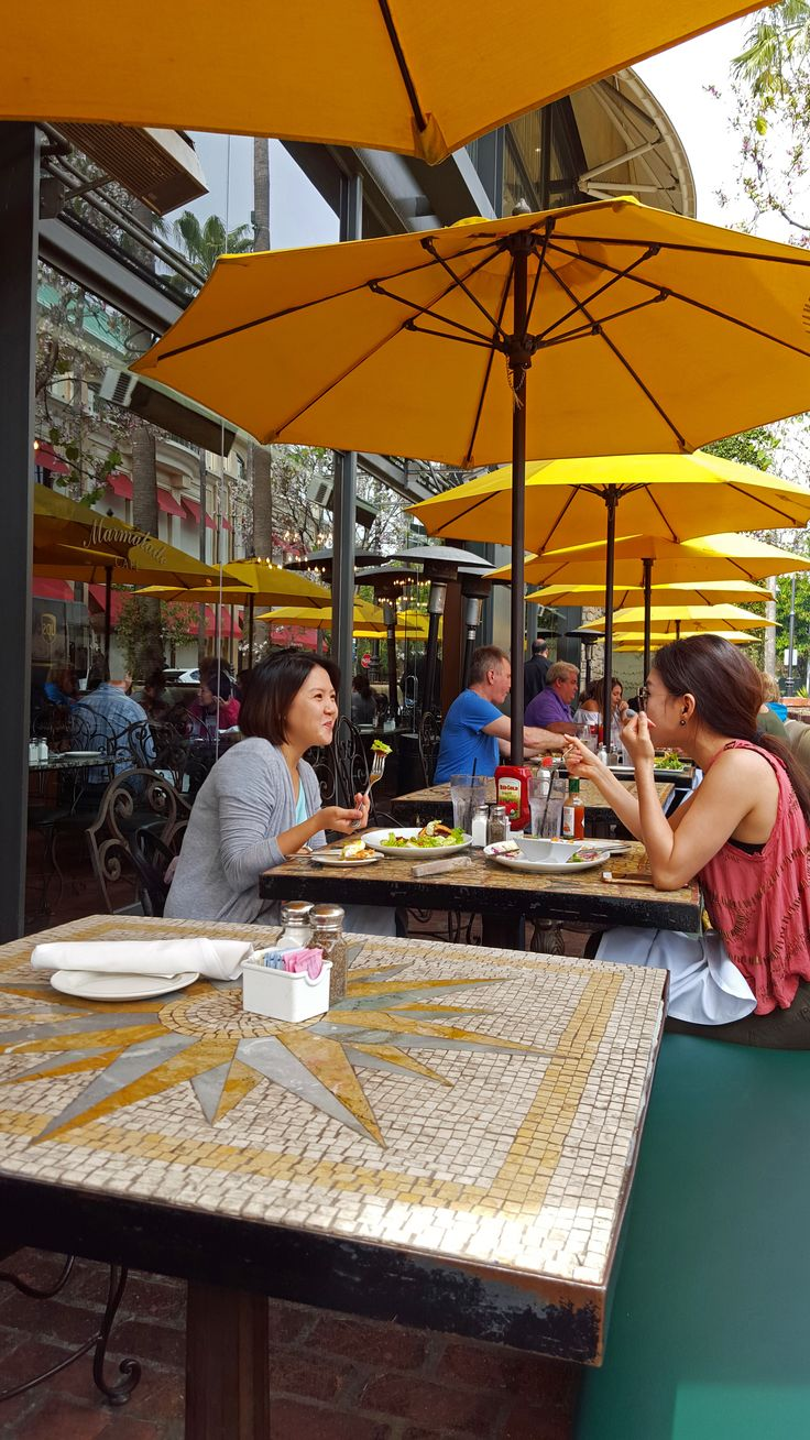 Marmalade Cafe's outdoor patio with yellow umbrellas