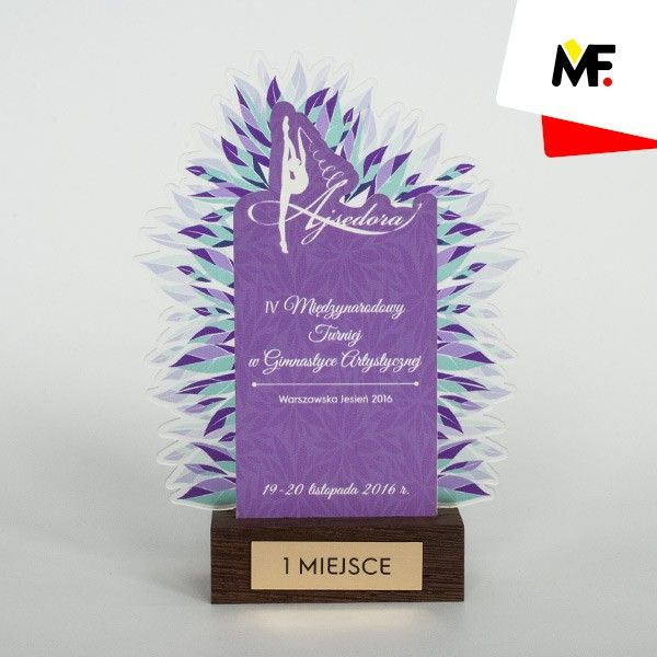 The visually light form of the trophy prepared for gymnastics tournament made of spatially textured satin plexiglas and colourful plexiglas. Trophy on the wooden base with plaque made of engraved laminte.   #trophy #statuettes #souvenirs #cups #awards socialhub.modernforms.pl