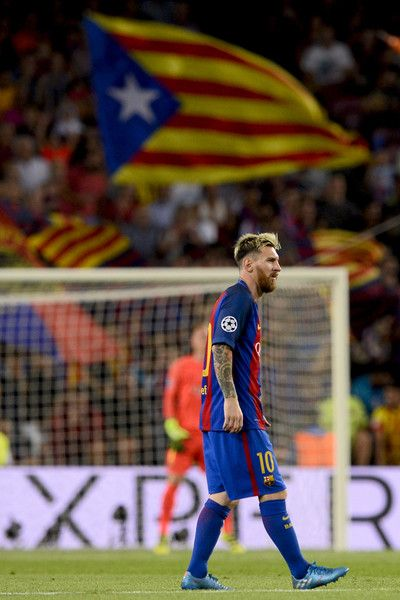 Barcelona's Argentinian forward Lionel Messi walks after scoring a goal during the UEFA Champions League football match FC Barcelona vs Celtic FC at the Camp Nou stadium in Barcelona on September 13, 2016. / AFP / JOSEP LAGO