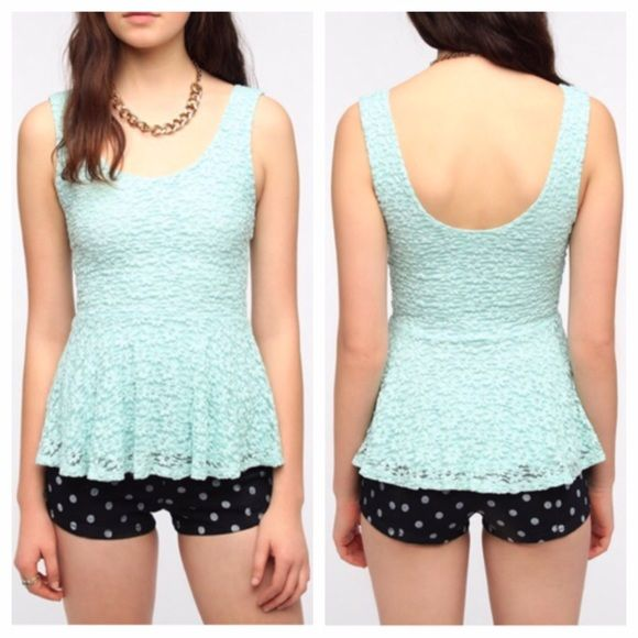 """{urban outfitters} mint lace peplum top Super-soft knit tank top from Pins and Needles. Lightweight construction with a daisy lace overlay. Topped with a skirted peplum at the waist. Scoop neck in the front and back. Cut in a fitted silhouette. UO Exclusive. Measurements: Model is 5'10"""" and is wearing a size Small. Measurements taken from a size Small. Chest: 28"""". Length: 24.5""""l from shoulder to hem. Content & Care: Nylon, rayon, spandex. Machine wash. Made in the USA. Gently worn. Actual…"""