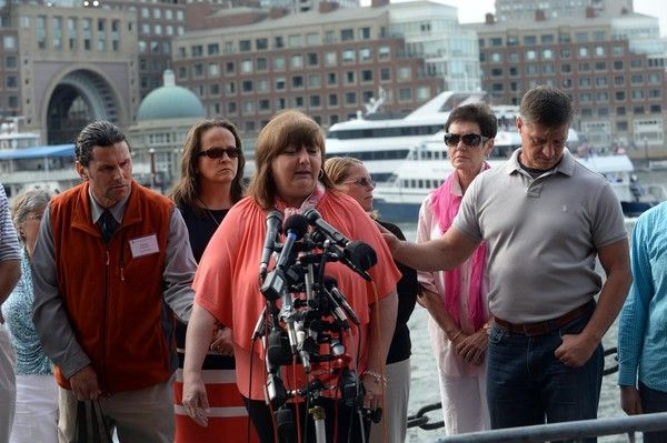 Liz Norden, who had two sons injured, speaks to the media as Karen Brassard, Carlos Arredondo, Melida Arredondo, Liz Norden, Jean Marie Parker, and Michael Ward listen outside the John Joseph Moakley United States Courthouse May 15, 2014 in Boston, Massachusetts. Ortiz announced the death penalty sentence for the convicted Boston Marathon bomber, Dzhokhar Tsarnaev.