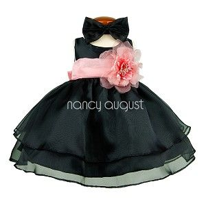 This sassy black organza layered baby dress features a sensational sleeveless style with a triple layer skirt. This beautifully simple organza tea length dress comes with a a adjustable sash tie in the back. Like many of our special occasion dresses, it is versatile and can be used as a flower girl dress, pageant dress, or even as a holiday party dress. No matter the occasion, this will make your little flower girl even more adorable. You can even add a detachable flower for the waistline!