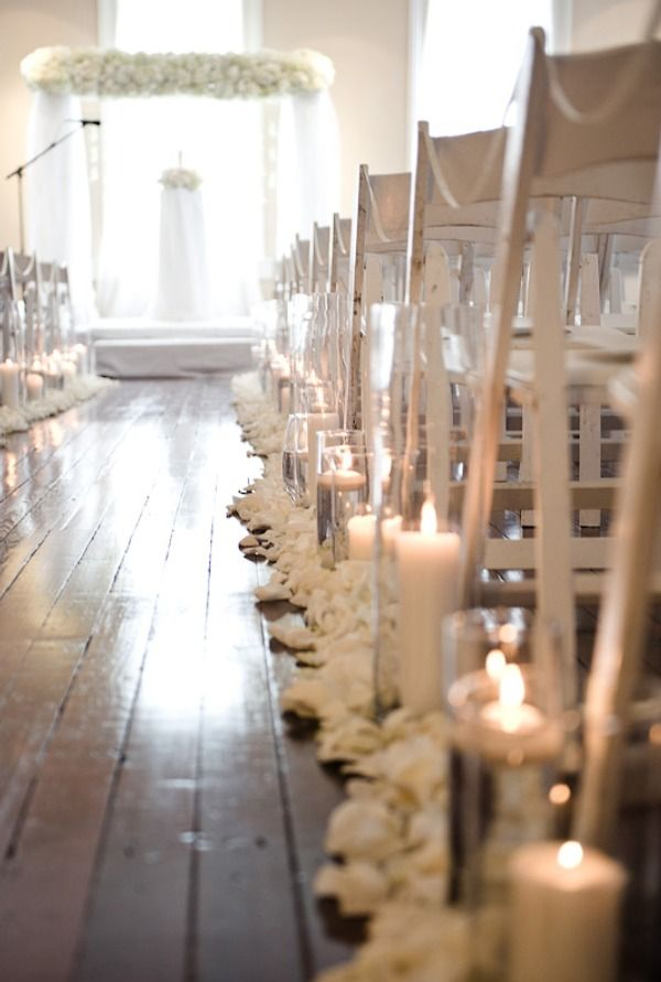 Candles up the aisle & ivory petals.  So simple and pretty.