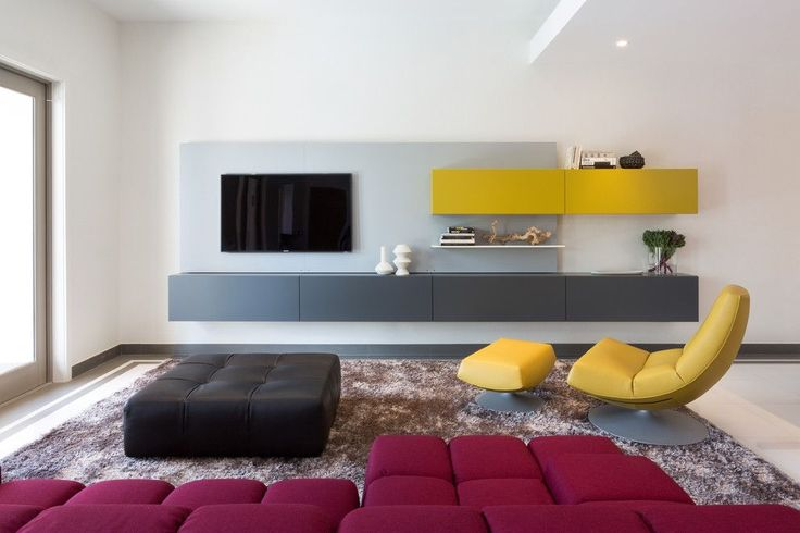 Grey and yellow is a great color mix you could use designing your living room's storage.