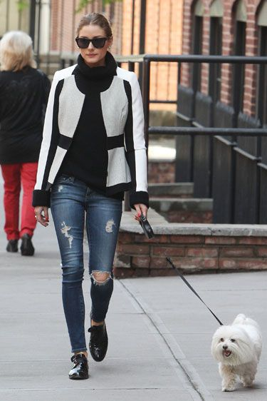 Jean Queens: A black and white color-blocked blazer and patent oxfords add instant sophistication to Olivia Palermo's distressed AG Adriano Goldschmied The Legging Ankle jeans.