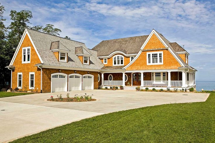<div><ul><li>A swoop roof, round windows and graceful eyebrow dormer all combine to give this Shingle style house plan its gorgeous exterior.</li><li>The covered porch wraps around three sides of the home with a screened porch at one end.</li><li>Beams top the ceiling in the huge, open living room and three sets of double doors take you out to the back porch.</li><li>A vaulted ceiling rises up in the unique octagonal dining room that is surrounded by windows on five sides.</li><li>Three of…