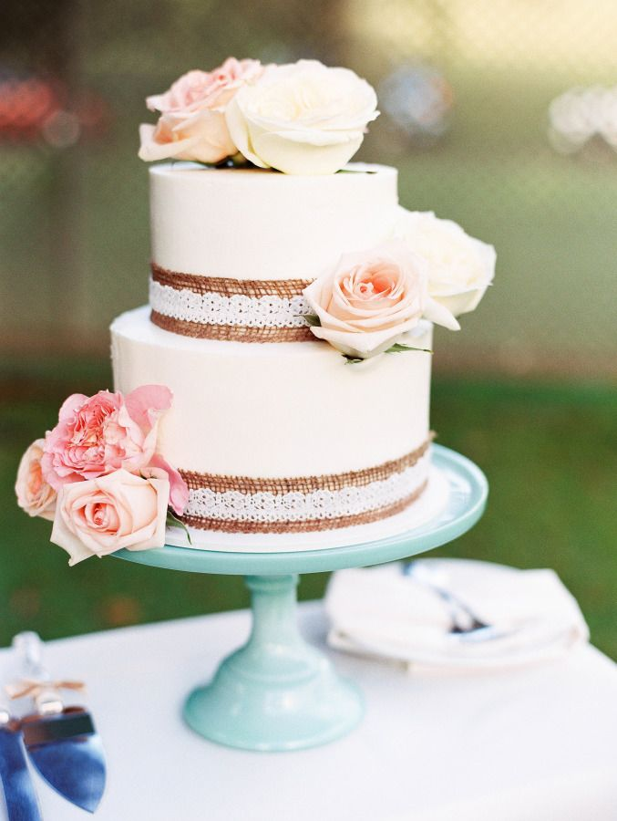 Rustic detailed cake with pink roses: http://www.stylemepretty.com/destination-weddings/2015/07/29/rustic-romantic-barn-wedding-in-hawaii/ | Photography: Ashley Goodwin - http://www.ashleygoodwinphotography.com/