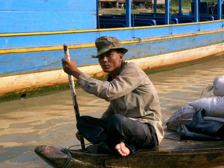 A man on Tonle Sap lake in Cambodia