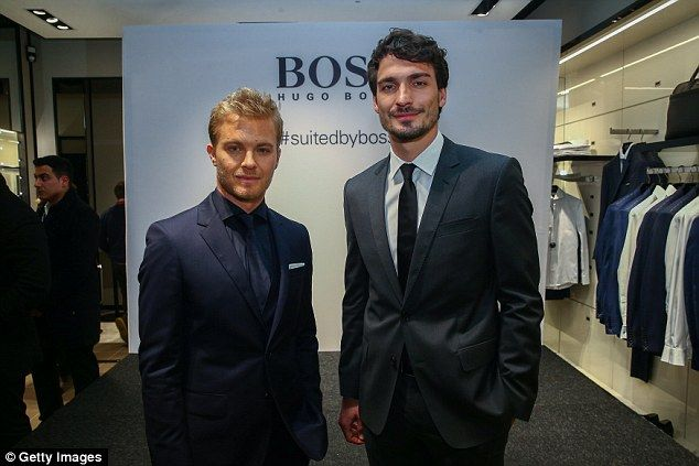 Rosberg, Formula One's championship leader, poses for a photo with Borussia Dortmund defender Hummels