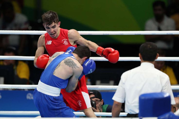 Best images from Aug. 14 at the Rio Olympics:      Aug 14, 2016; Rio de Janeiro, Brazil; Michael John Conlan of Ireland fights Aram Avagyan of Armenia during the men's bantam weight preliminaries in the Rio 2016 Summer Olympic Games at Riocentro - Pavilion 6.