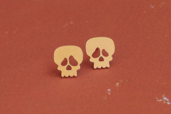 Sugar Skull Earrings , Gold Skull Jewelry , Skull Studs , Skull Posts , Candy Skull Earrings , Day of the Dead Jewelry , dia de los muertos Earrings , Skeleton Earrings  Cute, fun and effortlessly chic  These cute skull earrings will be sure to be your new go to every day accessory. The earrings are made ​​of brass plated gold and nickel free matte finish, and the ear pins are made ​​of sterling silver. The earrings comes with comfortable and secure silicon earring backs. Completes any…