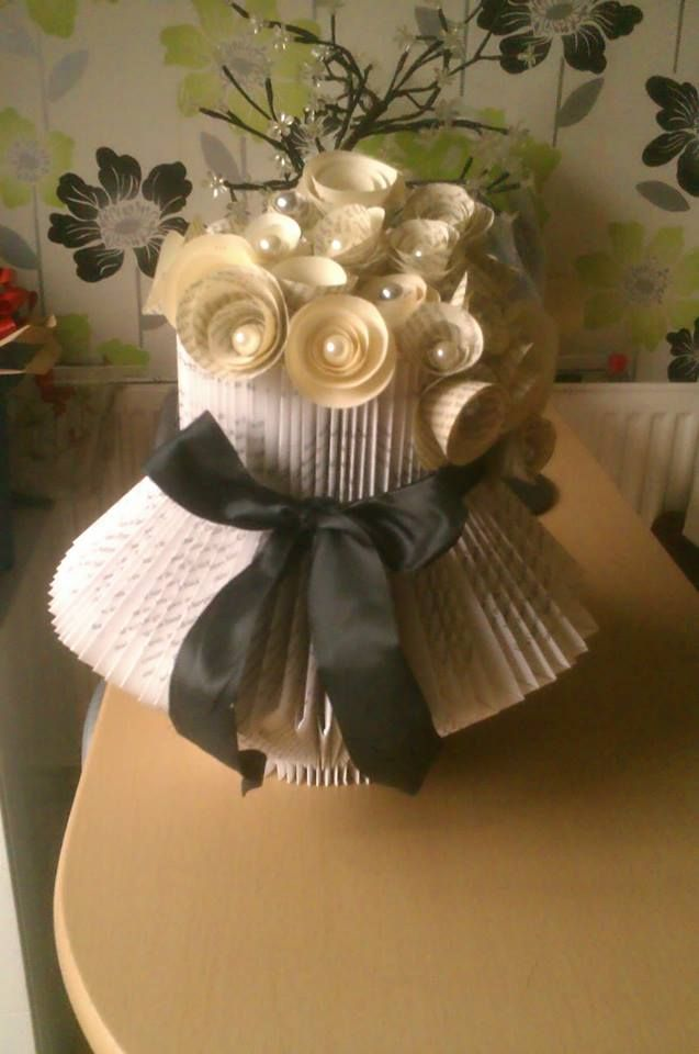 Folded book art....vase with paper roses