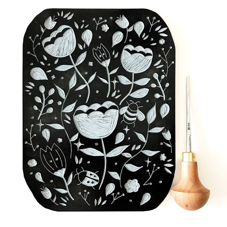 Magical garden lino cut lino print black ink bee floral pattern